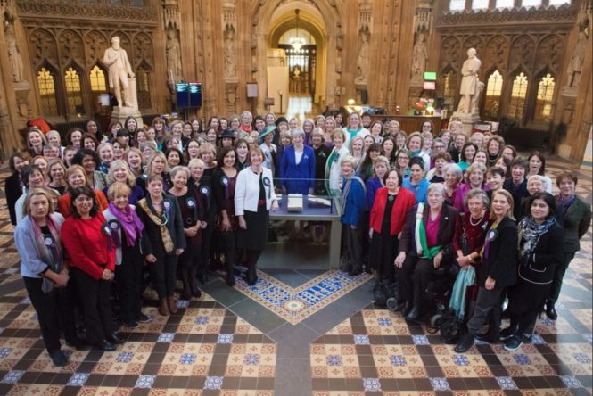 Prime Minister Theresa May with female members of parliament in celebration of the centenary of women's suffrage on 6th February 2018
